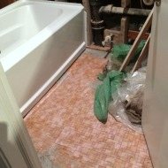Pink tile hiding under beige